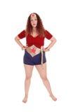 站立在超级妇女成套装备的妇女 库存图片