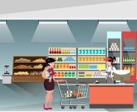 站立在超级市场的一名年轻出纳员妇女 库存例证