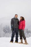 站立在雪的成熟妇女 图库摄影