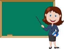 站立在黑板旁边的动画片女老师 免版税图库摄影