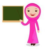 站立在黑板旁边的动画片女老师 免版税库存照片