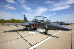 站立在Klin空军基地的雅克夫列夫雅克-130军用喷气机在一胜利天 免版税图库摄影
