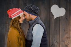 站立愉快的年轻的夫妇的综合图象面对面 图库摄影