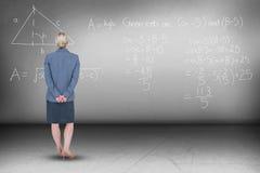 站立用后边手的女实业家的综合图象  库存照片