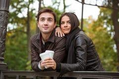站立用咖啡的夫妇户外 库存照片