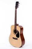 站立的声学吉他挺直 免版税库存图片