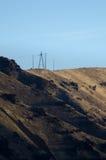 站立的电线杆高在地狱峡谷上的心脏 库存照片