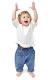 站立年轻的婴孩户内鼓掌和微笑 库存照片