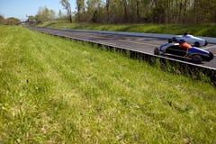 竞争在速度试验的两辆汽车 免版税库存图片