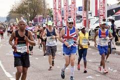 竞争在Ultra Marathon同志的英国赛跑者 免版税库存照片