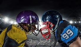 竞技场的美国橄榄球运动员 混合画法 库存照片