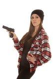 童帽的妇女和格子花呢上衣开枪点边 库存照片