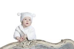 童帽的婴孩有大型机关炮的 库存照片