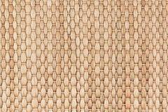 竹子被编织的米黄席子手工制造背景 免版税图库摄影