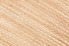竹子被编织的米黄席子手工制造背景 库存照片