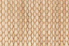 竹子被编织的米黄席子手工制造背景 图库摄影