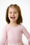 笑小女孩纵向  库存照片