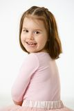 笑少许纵向的女孩 免版税图库摄影