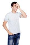 笑的人用在面孔的手 库存图片