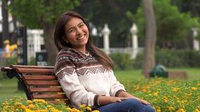 笑的女性西班牙青少年在公园 影视素材