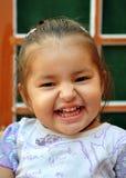 笑的女婴 免版税库存图片