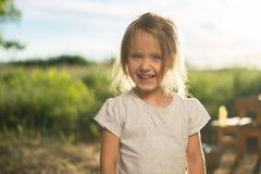 笑的孩子面孔特写镜头  图库摄影