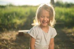 笑的孩子面孔特写镜头  库存图片