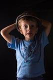 笑的男孩画象灰色背景的 免版税库存照片