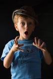 笑的男孩画象灰色背景的 免版税库存图片
