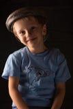 笑的男孩画象灰色背景的 免版税图库摄影
