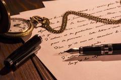 笔和怀表 库存照片