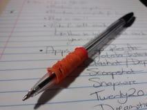 笔和笔记薄名单 库存照片