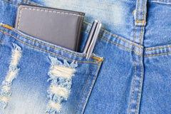 笔和笔记薄在后面口袋斜纹布有copyspace概念想法 库存图片