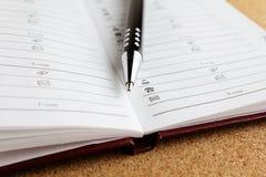 笔和笔记薄 免版税库存照片