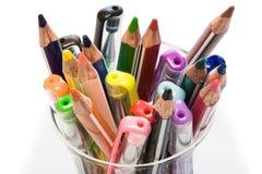 笔和铅笔在玻璃 免版税库存图片