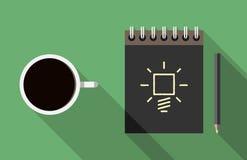 笔记本、咖啡和想法 免版税库存照片