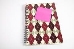 笔记本、柱子和笔 图库摄影
