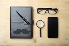 笔记本、电话、放大器和玻璃的拼贴画 库存图片
