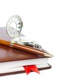 笔记本、笔和时钟 库存图片