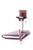 笔记本、铅笔和蜡烛台 免版税库存图片