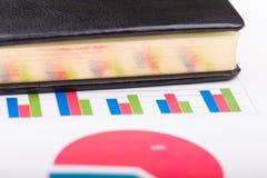 笔记本和图 免版税库存图片