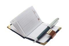 笔记本和圆珠笔 免版税库存照片