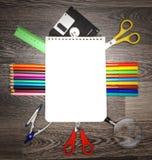 笔记本和学校工具。 免版税库存图片