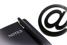 笔记本和电子邮件标志 免版税图库摄影