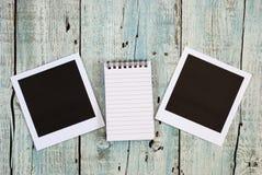 笔记本和立即照片框架 免版税图库摄影