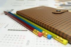 笔记本和铅笔有玻璃的 免版税库存照片