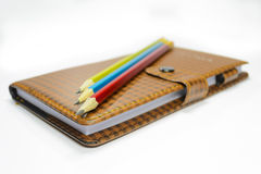 笔记本和铅笔 图库摄影