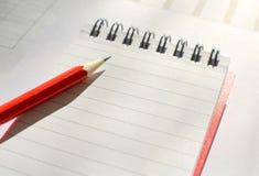 笔记本和铅笔 免版税库存照片