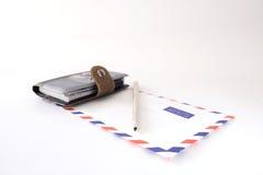 笔记本在白色背景的信封铅笔 免版税库存照片