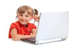 笔记本女小学生坐的微笑 库存照片